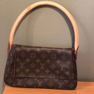 Authentic Louis Vuitton looping on monogram canvas